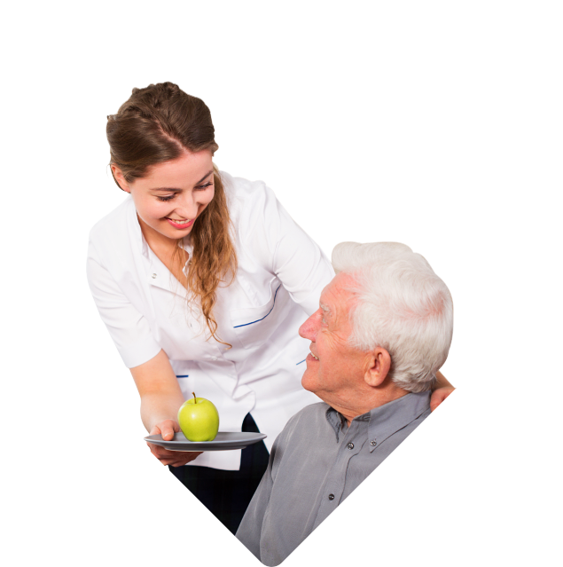 caregiver serving an apple to an elderly man