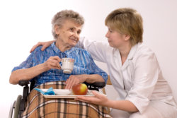 caregiver serving foods to senior woman